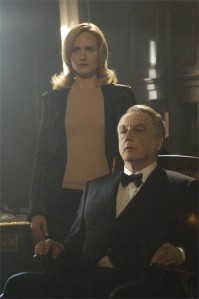 "Ella (AMBER VALLETTA) and her husband, Edward (BOB GUNTON), greet returning family members in the supernatural thriller from the writer/director team behind the international hit ""Saw"" franchise, ""Dead Silence""."